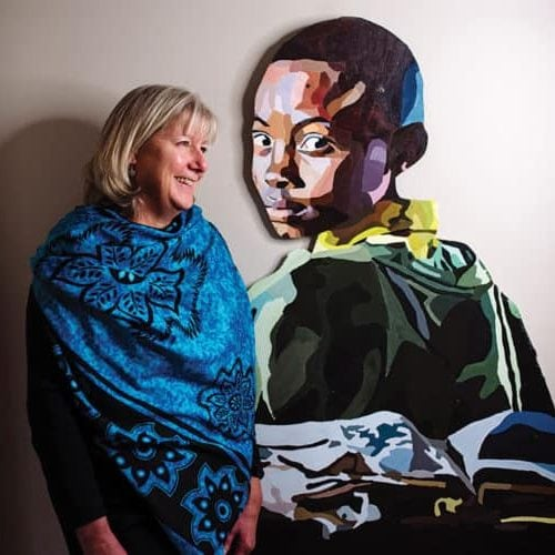 Sharon Runge stands near a gift painted by her daughter, Emma Runge, in their family home.