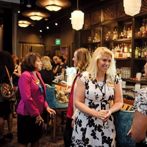 Karen Pitsley, owner of Transforming Architecture, chats with other members of the Business Women's Network group at the monthly meeting held at Cured restaurant in Howard County.